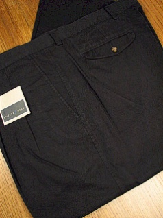 #162883. 48 LONG. BLACK Retail $  86.00 Cotton Casual Pants by CUTTER BUCK. CLASSIC TWILL PLEAT <font face=arial size=2><BR>Special Order Item.</font> <B>Item stocked by Manufacturer.  Allow up to 3 weeks for delivery.</B><br><b>This item r