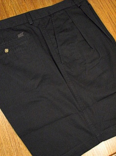 #205740. 50 REG. BLACK Retail $  72.00 Shorts by CUTTER BUCK. CLASSIC TWILL PLEAT <font face=arial size=2><BR>Special Order Item.</font> <B>Item stocked by Manufacturer.  Allow up to 3 weeks for delivery.</B>